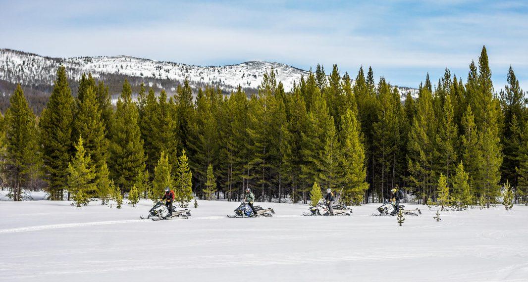 Group snowmobiling at The Ranch at Rock Creek, Montana