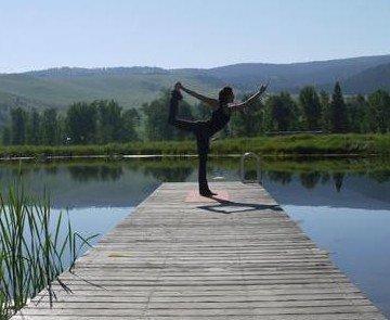A yoga practice at Bikini Beach at The Ranch at Rock Creek