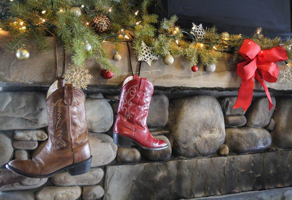 Christmas boots hang from the mantel at The Ranch at Rock Creek