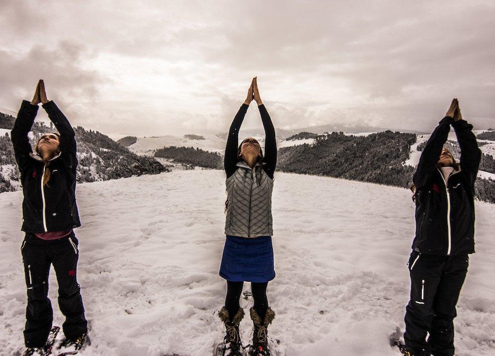 Three women practice snowga in Montana