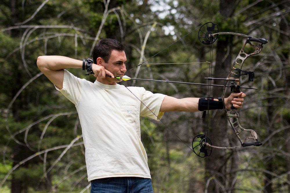 Aspiring photographer Benjamin Morgan tests out the archery course at The Ranch at Rock Creek