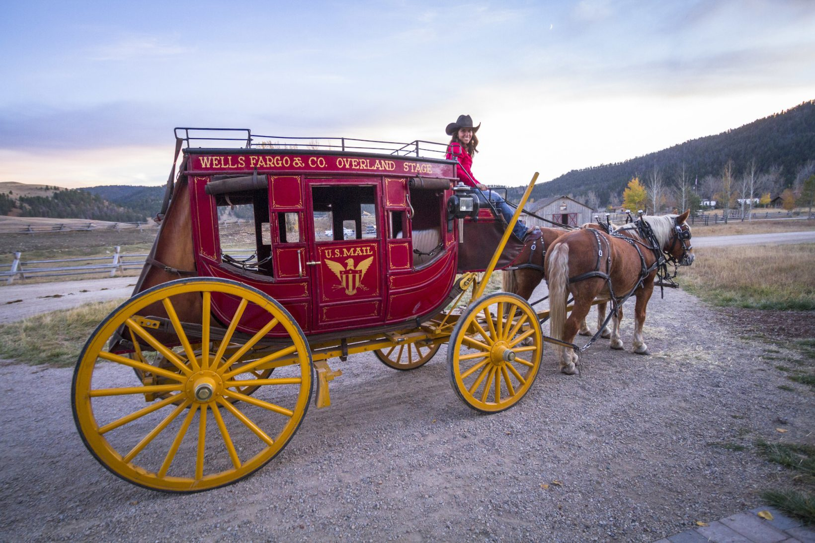 A Ranch wrangler drives a historic Wells Fargo stagecoach during Thanksgiving travel dates