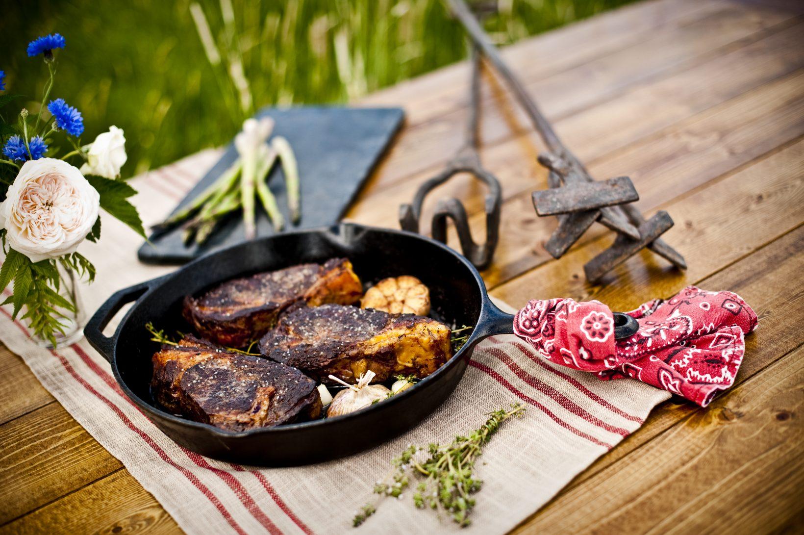 Cast iron seared ribeye steaks from local purveyor Yellowstone grass-fed beef