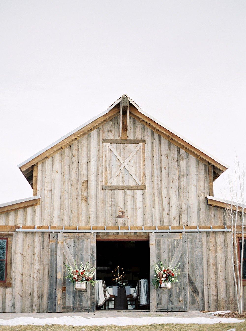 Peeking through the doors of the Buckle Barn at a wedding reception