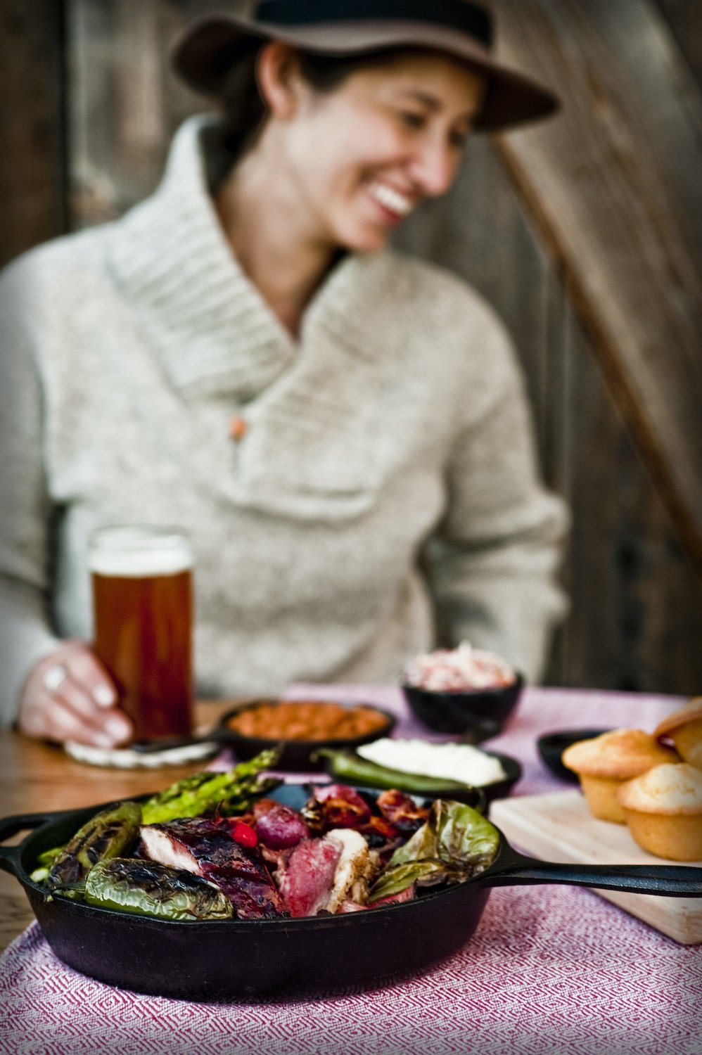Woman enjoys a local beer and barbecue meal