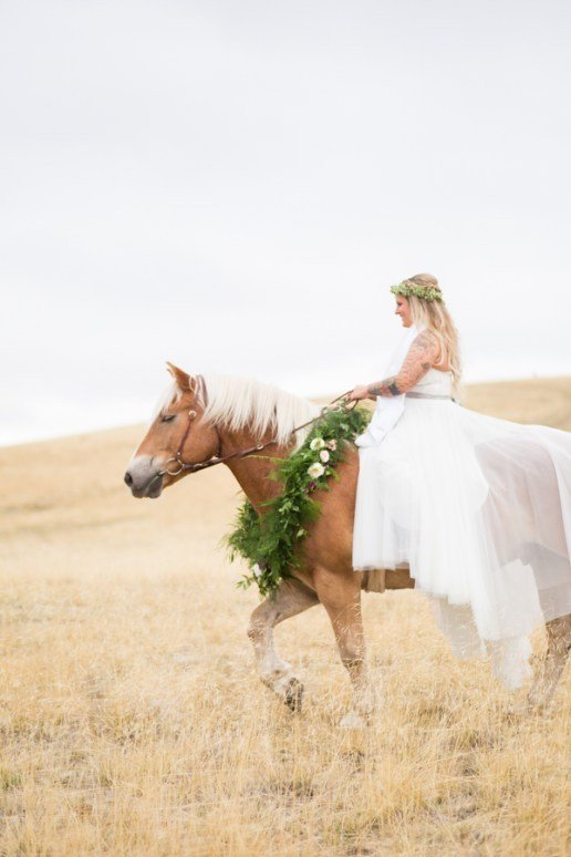 A bride rides her horse to her elopement wedding ceremony